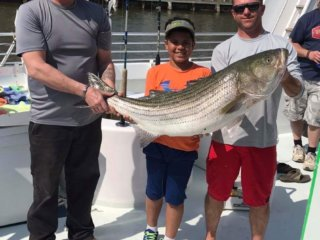 three guys holding a giant fish